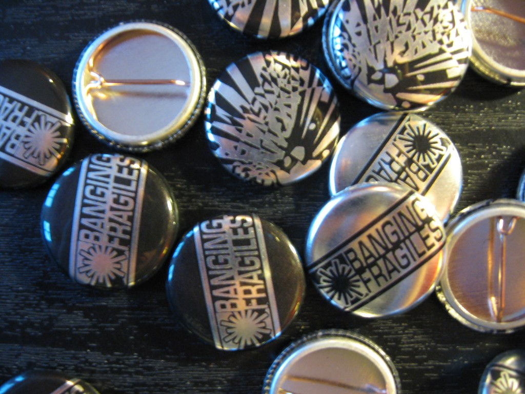 "Banging Fragiles - Metallic 1"" Pins"